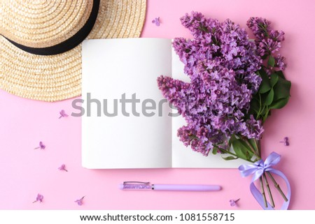 lilac and notebook on a colored background with space for inserting text. minimalism, top view, workplace. creative flatlay  #1081558715