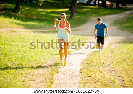 Young people jogging and exercising in nature at sunny day #1081623959