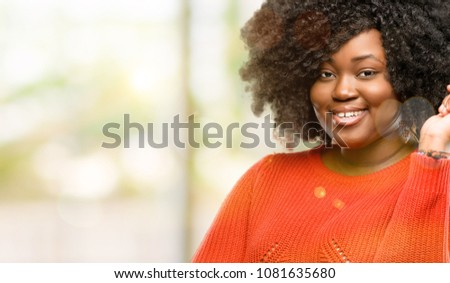 Beautiful african woman confident and happy with a big natural smile laughing, outdoor #1081635680