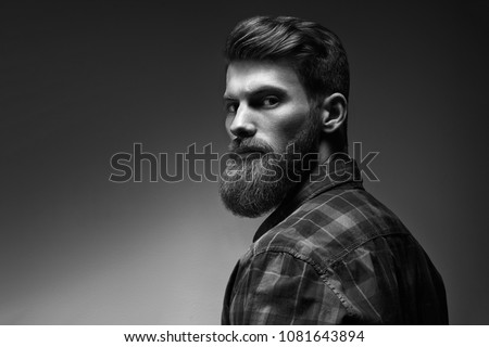 Black and white photo of bearded stylish businessman Handsome confident perfect hairstyle man indoor . Royalty-Free Stock Photo #1081643894