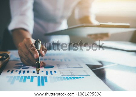 Administrator business man financial inspector and secretary making report calculating balance. Internal Revenue Service checking document. Audit concept #1081695596