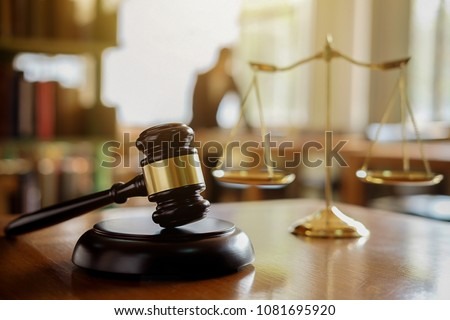 Judge gavel with Justice  lawyers having team meeting at law firm in background. Concepts of law. #1081695920