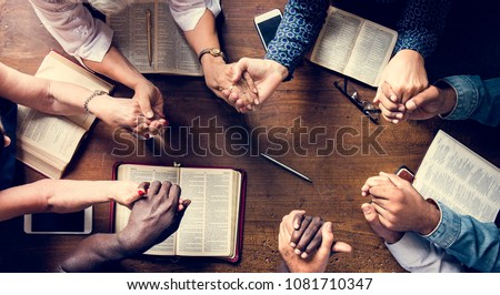 Group of people holding hands praying worship believe #1081710347