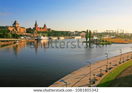 Left bank of the Oder river in Szczecin with the maritime museum and the terraces with a part of Grodzka Island, Szczecin, Poland  Royalty-Free Stock Photo #1081805342