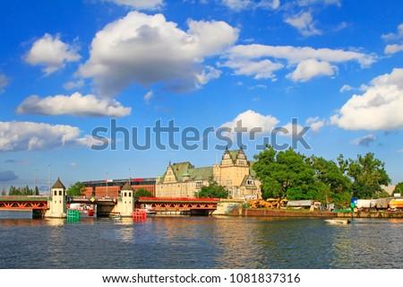 Landscape of Stettin (Szczecin) with the red metallic bridge (Dlugi bridge or Long bridge) with towers across the Oder river, Szczecin, West Pomerania, Poland Royalty-Free Stock Photo #1081837316
