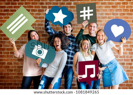 Happy young adults holding thought bubble with social medai concept icons #1081849265