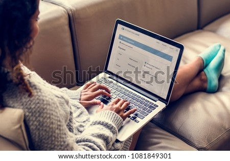 Woman working on a laptop Royalty-Free Stock Photo #1081849301