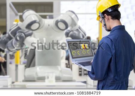 Industry 4.0 Robot concept .Engineers use laptop computers for machine maintenance, automation tools, robot arm at the factory. #1081884719