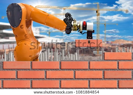 Bricklayer robot working for building brick wall in construction site .concept of robotic technologies in construction industry.