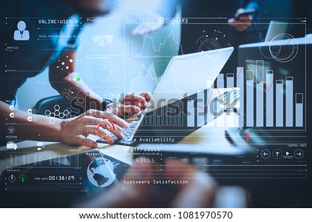 Intelligence (BI) and business analytics (BA) with key performance indicators (KPI) dashboard concept.StartUp Programming Team. Website designer working digital tablet dock keyboard. Royalty-Free Stock Photo #1081970570
