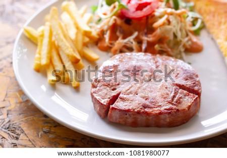 Ham steak and vegetable salad #1081980077