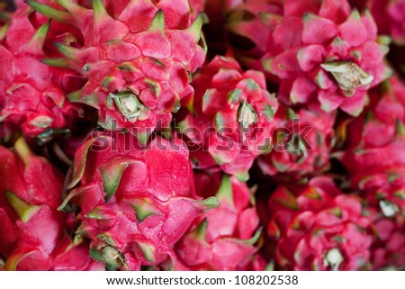 Fresh dragon fruits on sale in a food market in Thailand #108202538