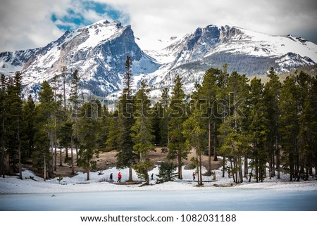 Landscape view of Rocky Mountains National Park in Colorado with trees in the foreground and mountains in the background. #1082031188