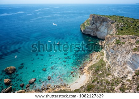 Aerial view of coast with clear turquoise sea - Cagliari, Sardinia, Sella del Diavolo.  #1082127629