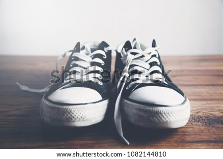 Pair of  sneakers on wooden table #1082144810