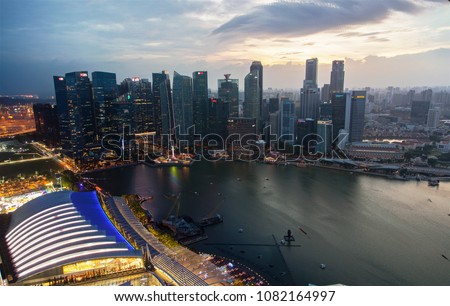 Singapore / Republic of Singapore - April 02 2018: This combined image 316 photos taken during sunset in Singapore from the roof of Marina Bay Sands. Time slice photography #1082164997