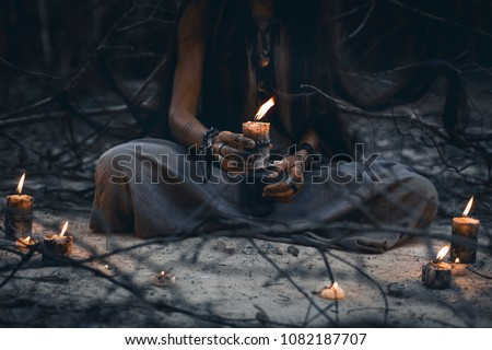 woman hands holding candle close up Royalty-Free Stock Photo #1082187707