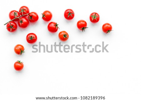 Fresh red tomatoes scattered on white background top view copy space #1082189396