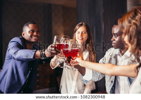 Happy young diverse people smiling and toasting with wine #1082300948