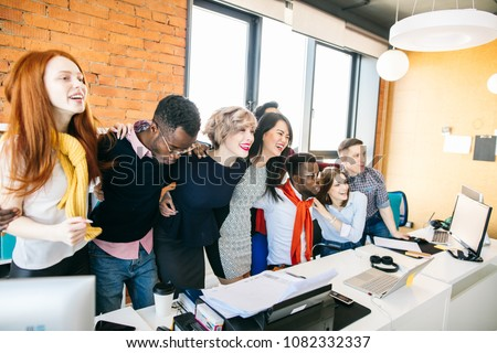 multi racial co-workers are embracing to show their common intent. identity of views concept #1082332337