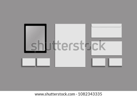 Black white and gray color mock-up of stationery, a template for brand identification on a grey background. Envelopes, sheets of paper #1082343335