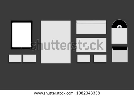 Black white and gray color mock-up of stationery, a template for brand identification on a grey background. Envelopes, sheets of paper #1082343338