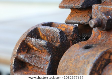 Selective focus of old rusty transmission gears. #1082377637