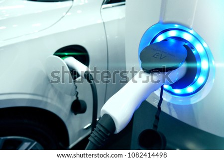 Power supply connect to electric vehicle for charge to the battery. Charging technology industry transport which are the futuristic of the Automobile. EV fuel Plug in hybrid car. #1082414498