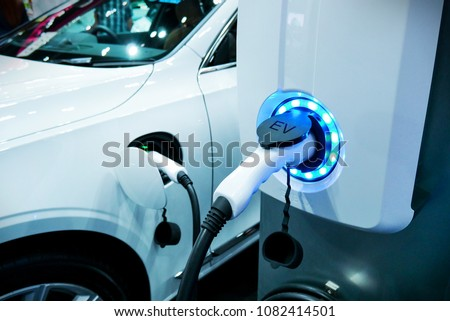 Power supply connect to electric vehicle for charge to the battery. Charging technology industry transport which are the futuristic of the Automobile. EV fuel Plug in hybrid car. Royalty-Free Stock Photo #1082414501