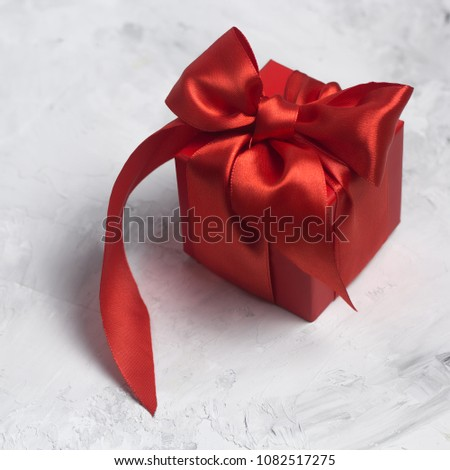 red gift box with red satin ribbon top view  #1082517275