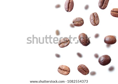 Coffee beans on white. Aroma coffee. #1082554373