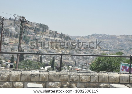 Jerusalem, Israel, June 16, 2010: Panoramic view from above to residential areas of the city. Day of Jerusalem #1082598119