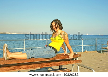 The girl at the sea on the bench. #10826383