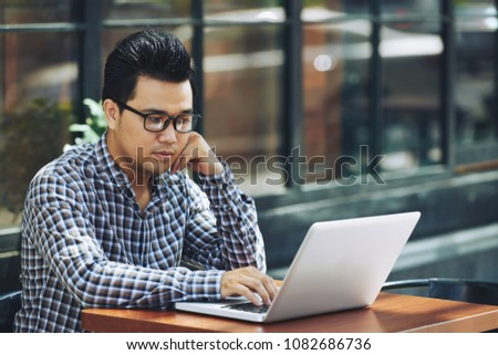 Freelancer thinking about topic for his new article #1082686736