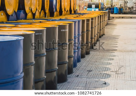 Industry oil barrels or chemical drums stacked up.chemical tank.container of  barrels of hydrocarbons.hazardous waste of black and blue tank oil. #1082741726