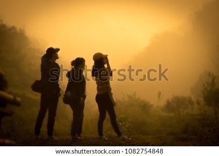 People traveling in the sunlight at dawn beautiful in DIEN BIEN - VIET NAM. DATE 22/-4/2018 #1082754848