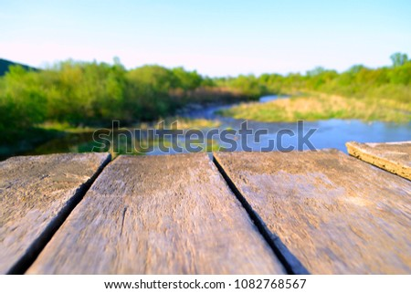 Old village wooden bridge across the river #1082768567