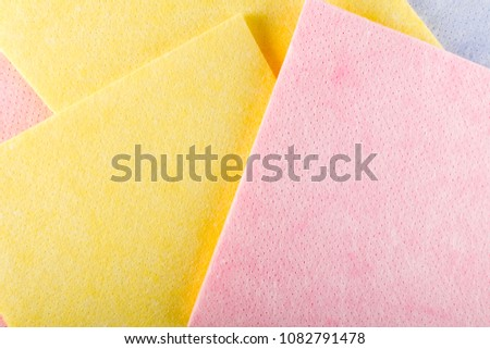 Geometric Abstract Background with Pastel Color Fabric or Texture. New Soft Color Cloth Top View. Absorbent Microfiber Towels with Place for Text #1082791478