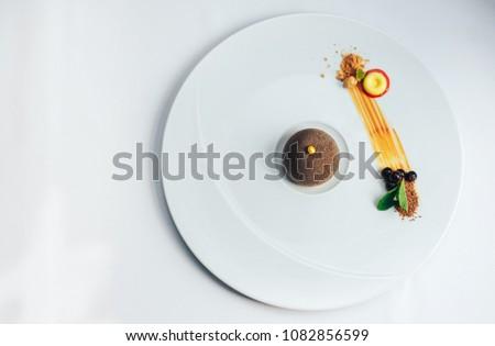 Chocolate dessert presentation on a big white plate #1082856599