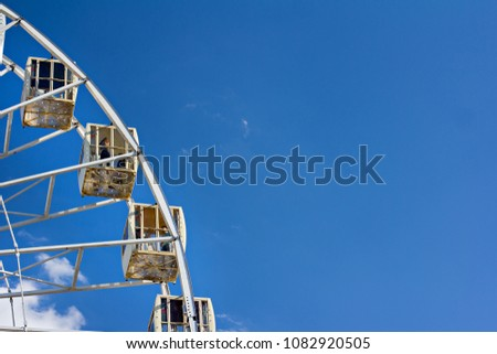 Ferris wheel on a blue sky background. #1082920505