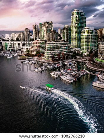 Vancouver British Columbia Canada with boats in the foreground and colourful sunset and architecture in the background. #1082966210