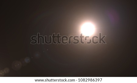 Realistic lens flare light effect , Beautiful rays of light over black background #1082986397