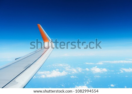 Airfoil and Cloudy Blue sky Royalty-Free Stock Photo #1082994554