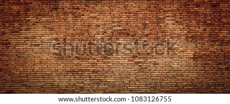 Old grunge brick wall background with vignetted corners #1083126755