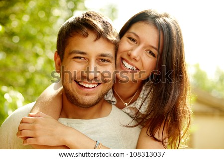 Portrait of a happy couple laughing at camera