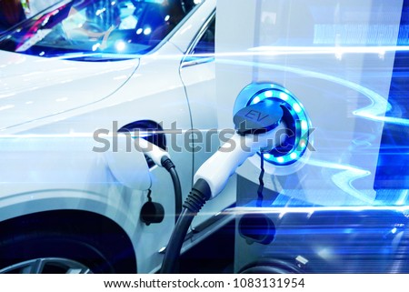 Power supply connect to electric vehicle for charge to the battery. Charging technology industry transport which are the futuristic of the Automobile. EV fuel Plug in hybrid car. #1083131954