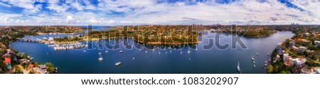 Middle harbour of Sydney - wide aerial panorama from Spit Bridge to Mosman and lower north shore suburbs with distant CBD suburbs on the horizon. Royalty-Free Stock Photo #1083202907