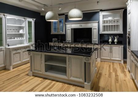 Renovated kitchen interior in dark tones #1083232508