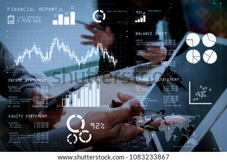 Financial report data of business operations (balance sheet and income statement and diagram) as Fintech concept.two colleague web designer discussing data and digital tablet and computer laptop. #1083233867