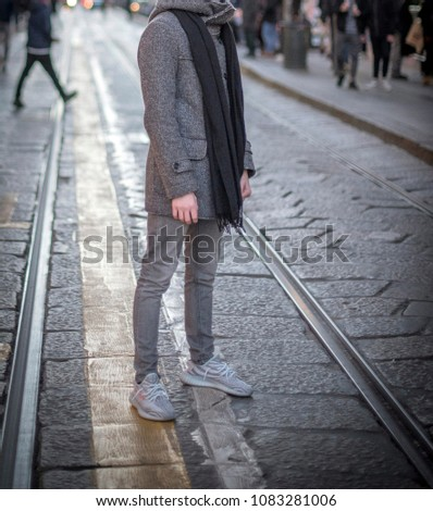 Milan, Italy - January 01, 2018: Man wearing a pair of Adidas Yeezy in the street #1083281006